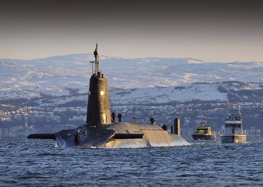 Nuclear submarine HMS Vanguard arrives back at HM Naval Base Clyde, Faslane, Scotland following a patrol. Date29 November 2010, 16:00:21 SourceDefence CPOA(Phot) Tam McDonald This file is licensed under the Open Government Licence v1.0.