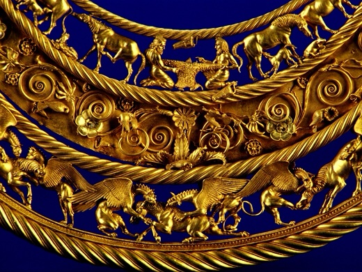 "Gold Scythian pectoral, or neckpiece, from a royal kurgan in Tolstaya Mogila, Ordzhonikidze, Ukraine, dated to the second half of the 4th century BC. The central lower tier shows three horses, each being torn apart by two griffins.""  Photo by Д.Колосов"