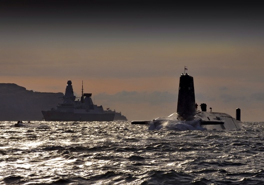 Nuclear Submarine HMS Vanguard Passes HMS Dragon as She Returns to HMNB Clyde, Scotland