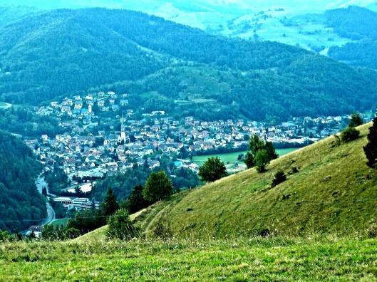 """Schönau im Schwarzwald seen from the observation platform at the cross """"Holzer Kreuz"""" in Fröhnd, public domain via wikipedia, brightened"""