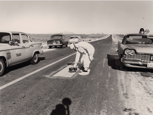 Checking radiation after nuclear accident Jan. 1961 Idaho