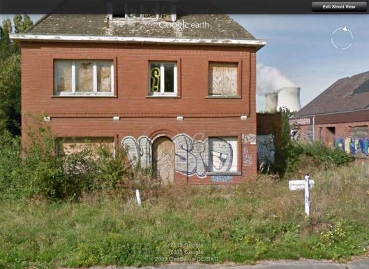 House boarded up graffiti near Doel NPS
