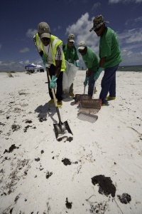 Deepwater Horizon Response, 100727-G-9091S-43,  USCG Photo by Dave Silva. cleaning tar balls in Florida, Pensacola, FL