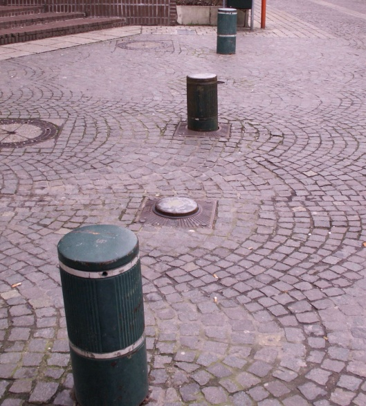 Bollards cropped Public Domain via wikiepdia