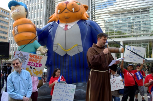 CIEL, BY-NC-SA Monk speaking in protest against OceanaGold lawsuit against El Salvador