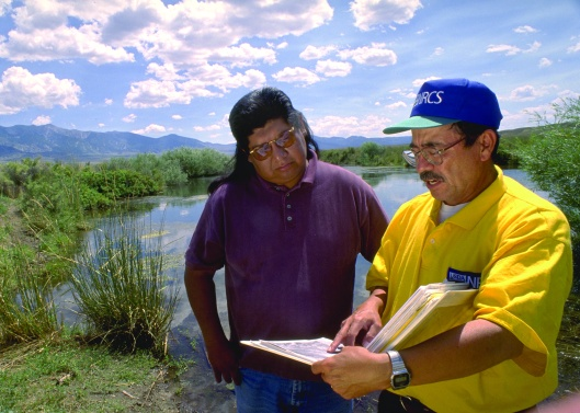 Milton Hooper (left), Environmental Specialist at the Goshute Indian Reservation, and Carlos Garcia, NRCS, review a riparian management plan for the reservation