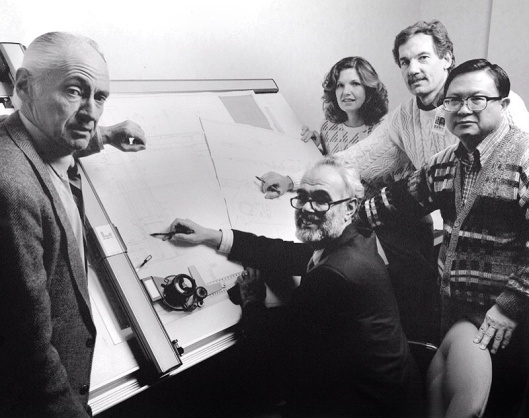 Solar Energy Research Institute (SERI) Wind Systems Branch staff, before the lab was renamed as NREL. From left, Palmer Carlin, Bob Thresher, Sue Hock, Darrell Dodge, and Peter Tu, at the drawing board.  Photo by Warren Gretz