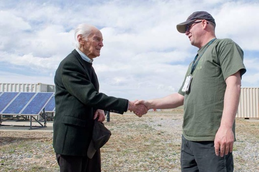 NREL Senior Engineer Palmer Carlin, left, is a staff favorite at the National Wind Technology Center. He is often greeted by fellow researchers such as Kevin Harrison, who saw him outside and came up to say hello. Photo by Dennis Schroeder-NREL