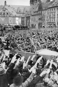 Crowd Salutes Hitler in passing car Crowd salutes Hitler:  Attribution: Bundesarchiv, Bild 137-004055 / CC-BY-SA