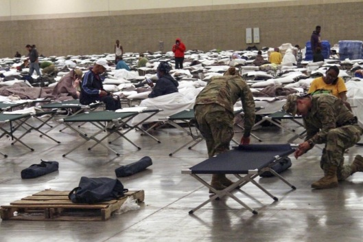 Soldiers from the Louisiana National Guard's 2228th Military Police Company headquarted in Alexandria setting up cots inside of the Baton Rouge River Center August 15, 2016 after major flooding pushed them from their homes over the last several days.. Guardsman here are also assisting Louisiana State Police with security. (Photo Credit: Spc. Garrett L. Dipuma, Army National Guard )