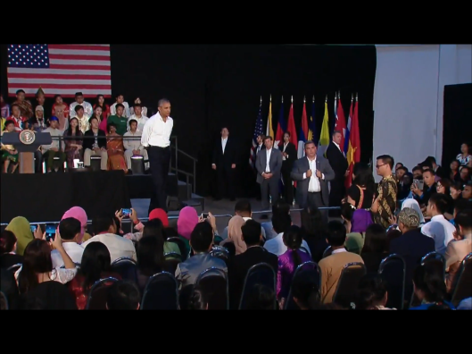 Obama Laos walkes across stage