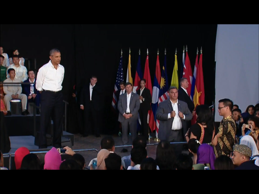 Obama looking at lady from Malaysia