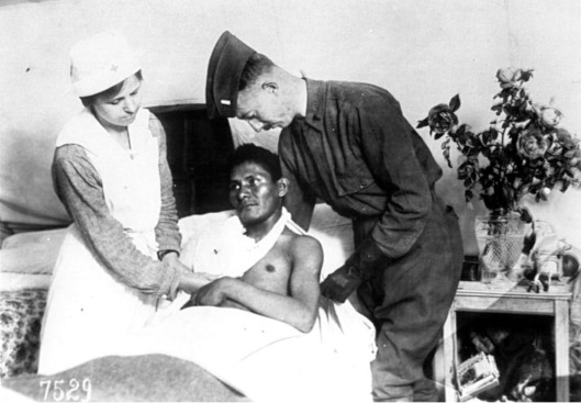 Wounded Choctaw soldier in the U.S. service is attended. World War I, U.S. National Red Cross Hospital No. 5, Auteuil, France, c.1917-1918 Date August 1917