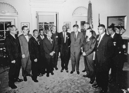 Civil rights leaders meet with President John F. Kennedy in the Oval Office of the White House after the March on Washington, D.C.. * Left to Right — Willard Wirtz, Matthew Ahmann, Martin Luther King, Jr (SCLC), John Lewis, Rabbi Joachin Prinz, Eugene Carson Blake, A. Philip Randolph, President John F. Kennedy, Vice President Lyndon Johnson, Walter Reuther (UAW), Whitney Young, Floyd McKissick. * Others not in order: Roy Wilkins (NAACP). Date 28 August 1963