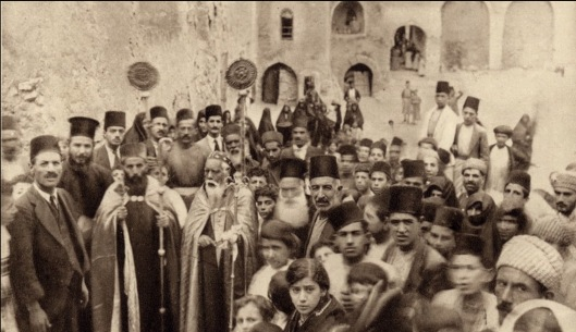 Celebration at a Syriac Orthodox monastery in Mosul, Ottoman Syria, early 20th century, public domain via wikimedia